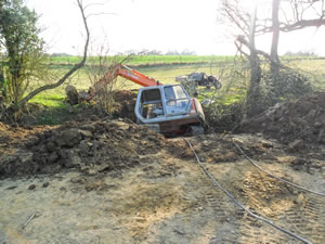 Recovery of digger from ditch